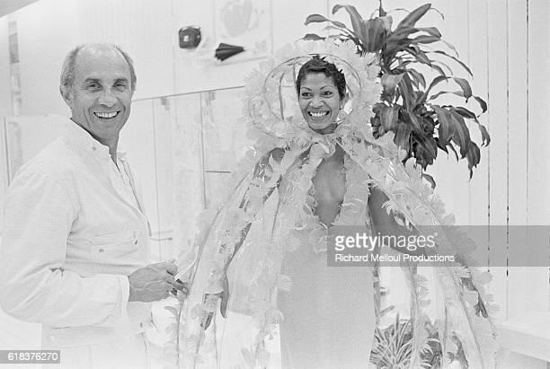 French fashion designer Andre Courreges and one of his models share a laugh backstage at his 19751976 autumnwinter fashion show in Paris Courreges...