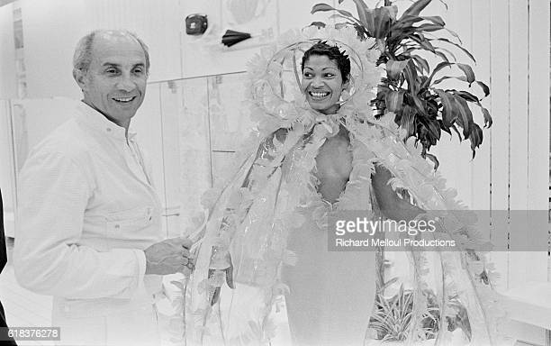 French fashion designer Andre Courreges and one of his models share a laugh backstage at the Chanel 19751976 autumnwinter fashion show in Paris...