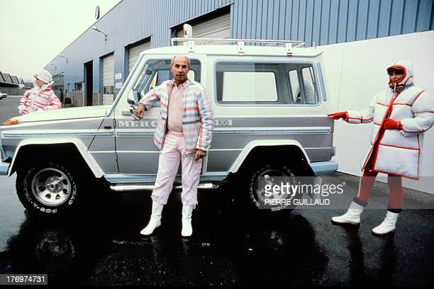 French fashion designer Andre Courreges with two models presents on December 10 in Mercedes center of La Courneuve the 4/4 MercedesBenz which he has...