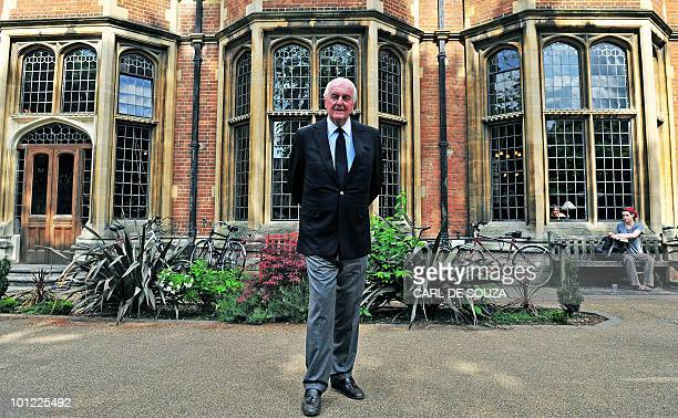 French fashion designer aristocrat and founder of Fashion label Givenchy Hubert de Givenchy poses before a speech at Oxford University Union...