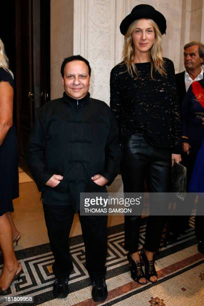 French fashion designer Azzedine Alaia poses with Zadig et Voltaire stylist Cecilia Bonstrom at the launching of his exhibition 'Alaia' at the...