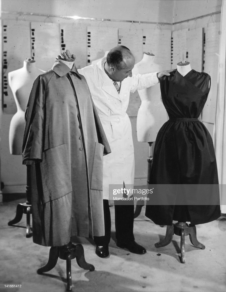 Christian Dior Amid Some Dummies In His Atelier : News Photo