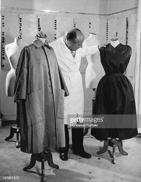 French fashion designer Christian Dior amid some dummies in his atelier Paris 1940s