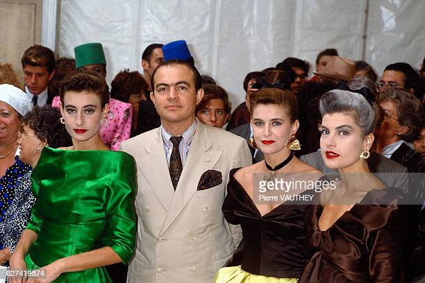 French fashion designer Christian Lacroix stands with fashion models including Marie Seznec at his 19871988 FallWinter fashion show in Paris The show...