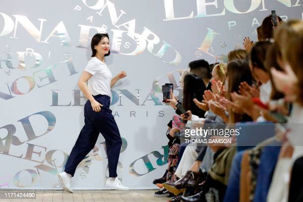TOPSHOT French Fashion designer Christine Phung acknowledges the audience following the show by Leonard Paris during the Women's SpringSummer 2020...
