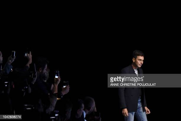 French fashion designer for Celine Hedi Slimane acknowledges the audience at the end of the Celine SpringSummer 2019 ReadytoWear collection fashion...