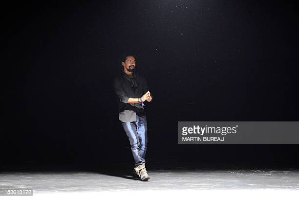 French fashion designer Haider Ackermann acknowledges the public during the Spring/Summer 2013 readytowear collection show on September 29 2012 in...