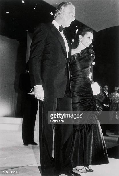 French fashion designer Hubert De Givenchy escorts actress Audrey Hepburn to the Givenchy tribute at the Fashion Institute of Technology The tribute...