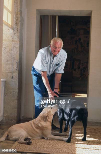 French fashion designer Hubert de Givenchy playing with his dogs at home, the Château du Jonchet, in Touraine, France, 1st October 1995.