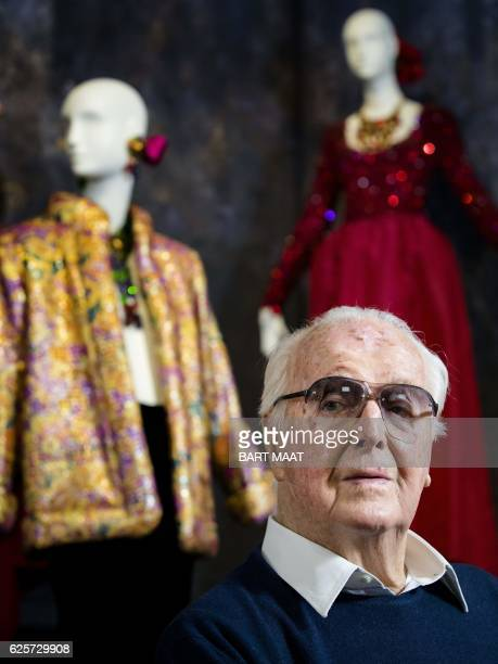 French fashion designer Hubert de Givenchy poses at the Gemeentemuseum in The Hague on November 23 2016 during a retrospective of the designer's work...
