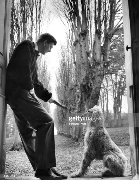 French fashion designer Hubert de Givenchy with his afghan hound Original Publication Picture Post White Is Right Original Publication People Disc...