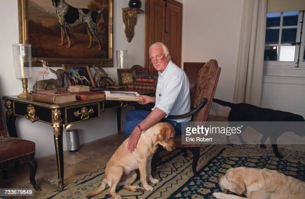 French fashion designer Hubert de Givenchy with his dogs at his home the Château du Jonchet in Touraine France October 1995