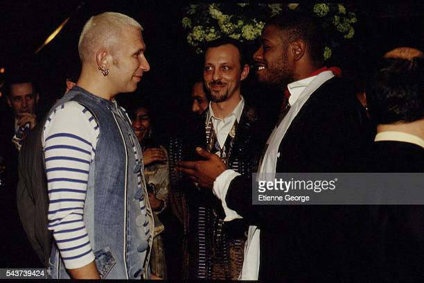 French fashion designer JeanPaul Gaultier French singer and composer Tom Novembre and actor Forest Whitaker on the set of the film PrêtàPorter...
