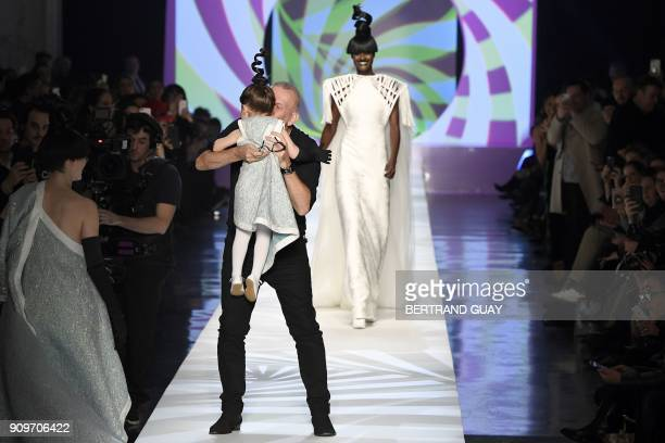 French fashion designer JeanPaul Gaultier kisses Ioni Conran daughter of model Coco Rochaat the end of the 2018 spring/summer Haute Couture...