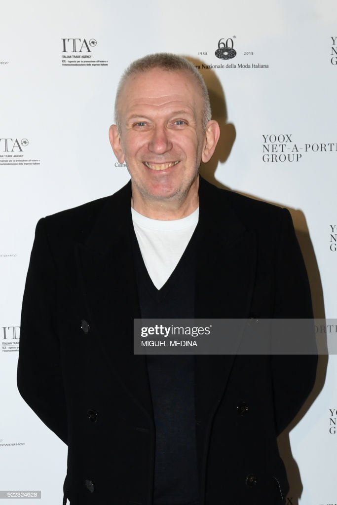 French fashion designer Jean-Paul Gautier poses upon the arrival to the exhibition preview of 'Italiana, Italy Through the Lens of Fashion' at Palazzo Reale in Milan, on February 21, 2018. / AFP PHOTO / Miguel MEDINA