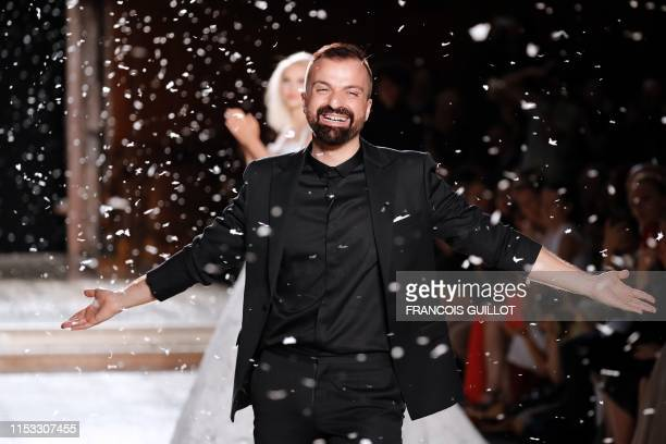 French fashion designer Julien Fournie acknowledges the audience at the end of his Women's Fall-Winter 2019/2020 Haute Couture collection fashion...