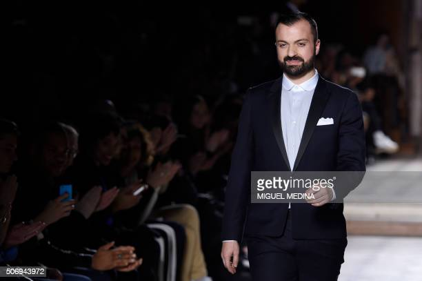 French fashion designer Julien Fournie acknowledges the audience at the end of his show during the 2016 spring/summer Haute Couture collection on...