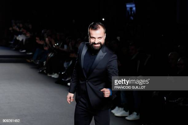 French fashion designer Julien Fournie acknowledges the audience at the end of the 2018 spring/summer Haute Couture collection fashion show on...