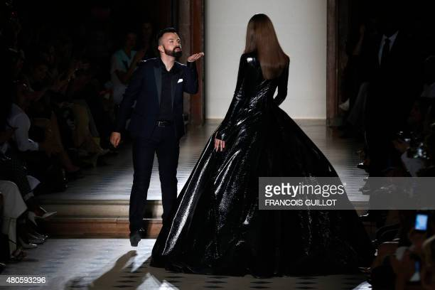 French fashion designer Julien Fournie acknowledges the public at the end of his 2015-2016 fall/winter Haute Couture collection fashion show on July...