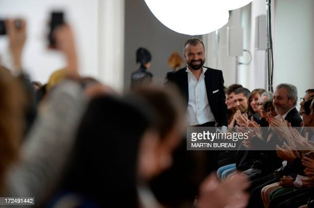 French fashion designer Julien Fournie acknowledgest the public during his Haute Couture Fall-Winter 2013/2014 collection show, on July 2, 2013 in...