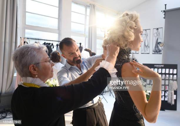 French fashion designer Julien Fournie and his workshop premiere Madame Jacqueline are pictured with model Michaela Tomanova during the shooting of a...