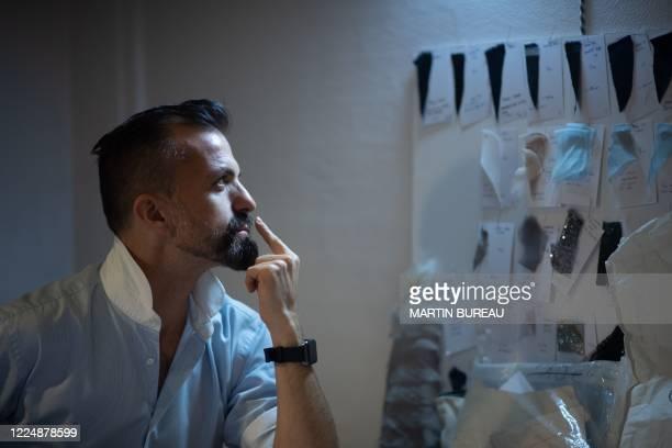 French fashion designer Julien Fournie looks on in his workshop in Paris, on June 18, 2020.