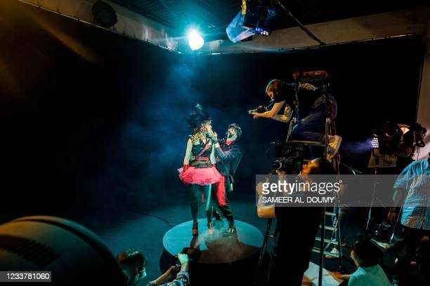 French fashion designer Julien Fournie performs a show with Belgian actress Deborah François in Paris on June 16 during the shooting of a film...