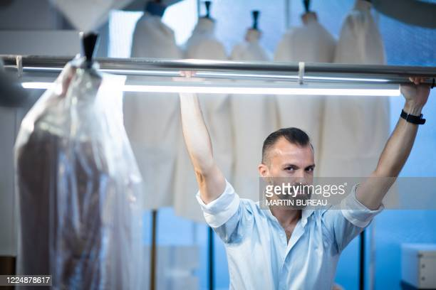French fashion designer Julien Fournie poses in his workshop in Paris on June 18 2020