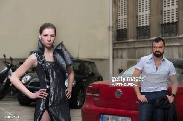 French fashion designer Julien Fournie poses with a model wearing a creation for the 2012 AutumnWinter Haute Couture collections in Paris on June 19...