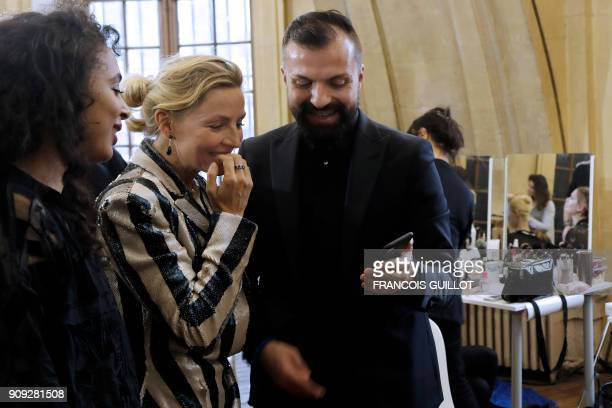 French fashion designer Julien Fournie speaks with people in the backstage during the preparations for Julien Fournie's fashion show as part of the...