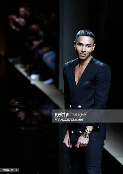 French fashion designer Olivier Rousteing acknowledges the audience at the end of the Balmain show during the men's Fashion Week 20162017 Fall/Winter...