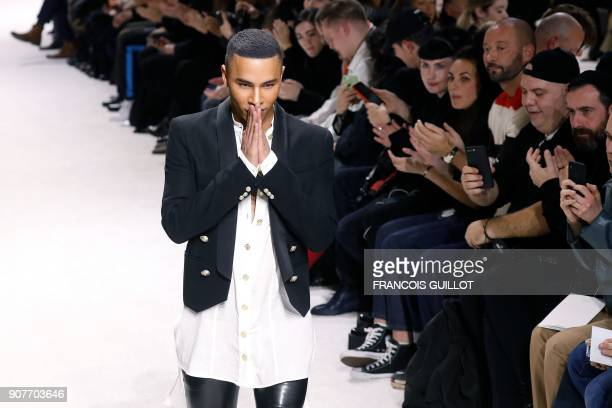 French fashion designer Olivier Rousteing acknowledges the audience at the end of the Balmain fashion show during the Men's Fall/Winter 2018/2019...