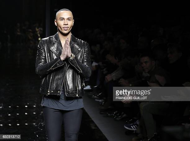French fashion designer Olivier Rousteing acknowledges the public at the end of the Balmain show during the men's Fashion Week for the Fall/Winter...