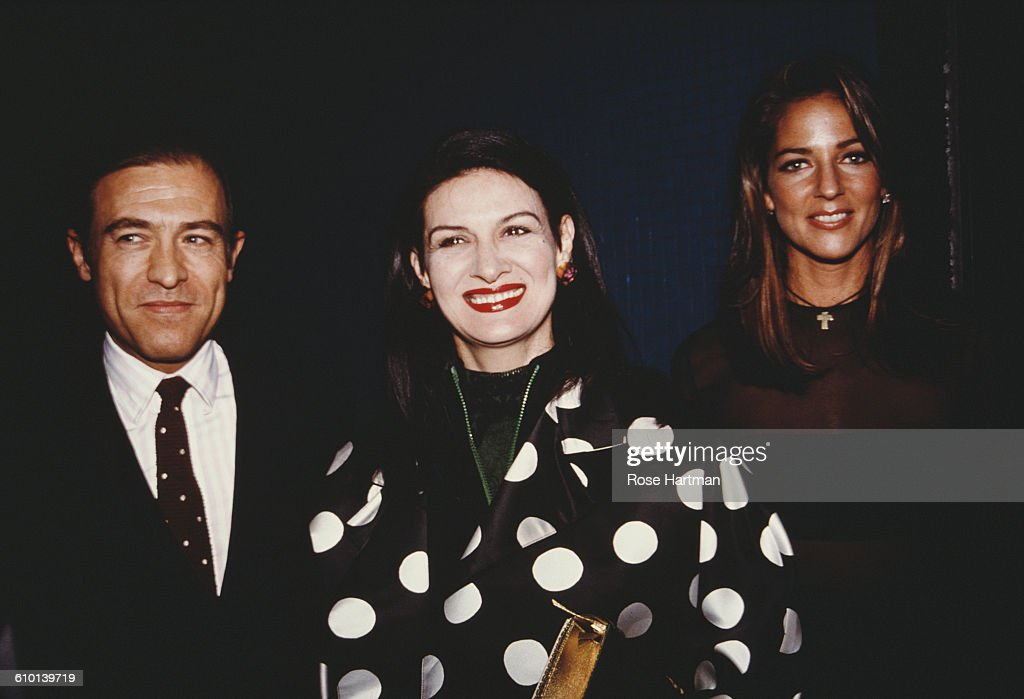 French fashion designer Paloma Picasso (centre) with husband Rafael Lopez Sanchez and Kelly Klein at a Pools launch party, circa 1990.