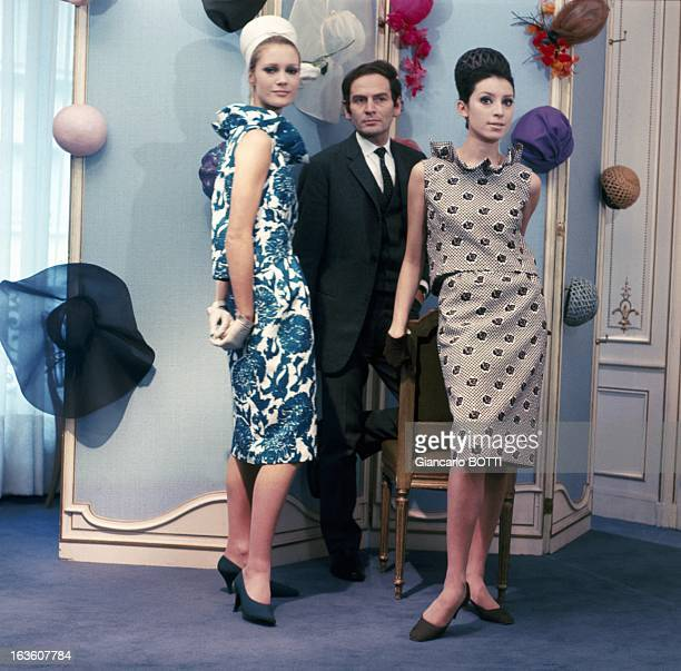 French fashion designer Pierre Cardin poses with two models
