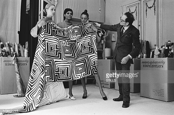 French fashion designer Pierre Cardin working in his shop in London United Kingdom in July 1970