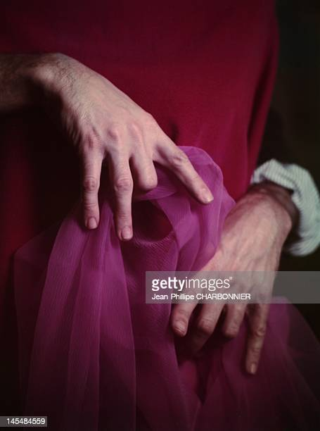 French fashion designer Pierre Cardin's hands playing with fabrics France