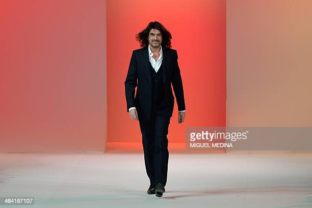 French fashion designer Stephane Rolland acknowleges the public at the end of his Haute Couture Spring-Summer 2014 collection show, on January 21,...