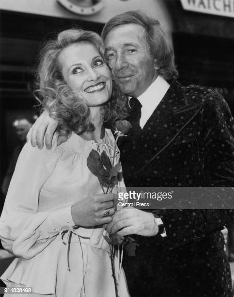French fashion designer Ted Lapidus receives a Valentine's Day rose from model Wendy Davis as he opens his new boutique on Bond Street London 14th...