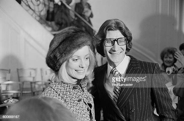 French fashion designer Yves Saint Laurent and French actress Catherine Deneuve at a party and fashion show held by Saint Laurent in Paris, France,...