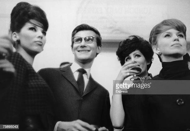 French fashion designer Yves Saint Laurent and his models celebrate the unveiling of his second spring collection at the House of Dior, 28th January...