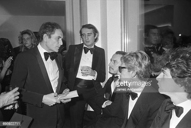 French fashion designer Yves Saint Laurent and his partner Pierre Bergé attend a charity gala at the Espace Cardin in Paris given by the actress...