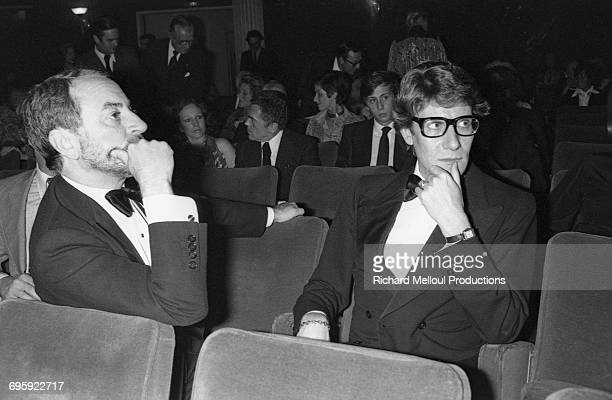 French fashion designer Yves Saint Laurent and his partner Pierre Bergé attend the first play by the writer FrançoisMarie Banier at the Modern...
