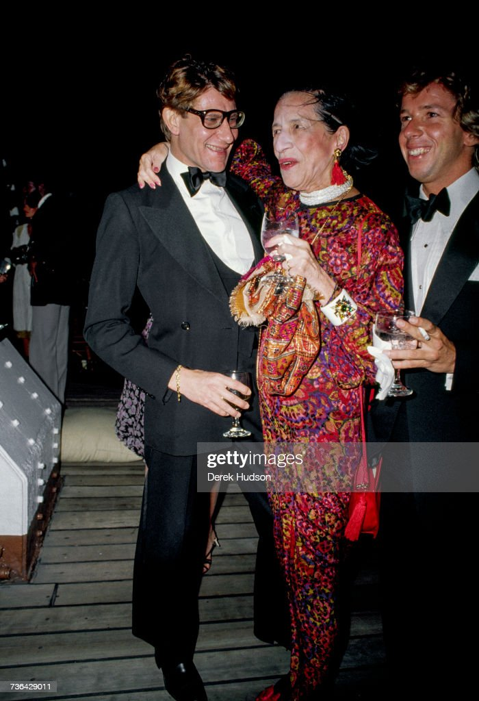 French fashion designer Yves Saint Laurent at a launch party for his Opium perfume line with the American fashion editor Diana Vreeland in 1981.