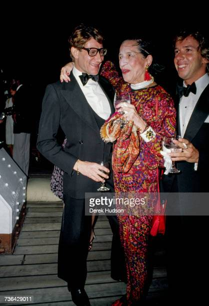 French fashion designer Yves Saint Laurent at a launch party for his Opium perfume line with the American fashion editor Diana Vreeland in 1981
