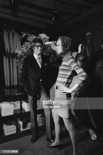French fashion designer Yves Saint Laurent at his boutique in Paris, France, with actress and customer Catherine Deneuve, 26th September 1966.