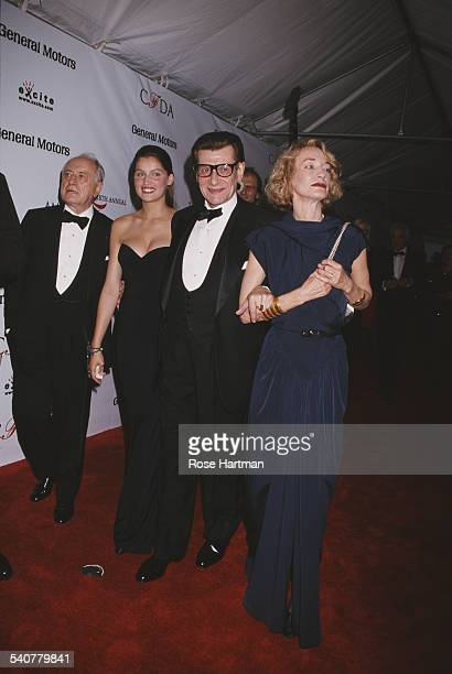 French fashion designer Yves Saint Laurent at the 18th annual CFDA awards at the 69th Regiment Armory in New York City USA 2nd June 1999 With him are...