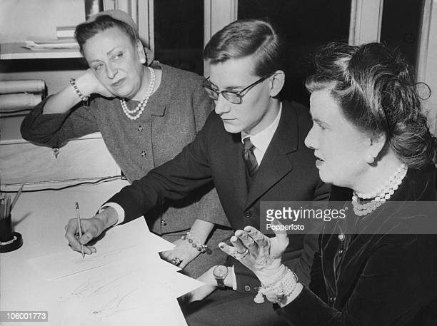 French fashion designer Yves Saint Laurent at the House of Dior in Paris with Dior business managers Raymonde Zehnacker and Marguerite Carre 25th...