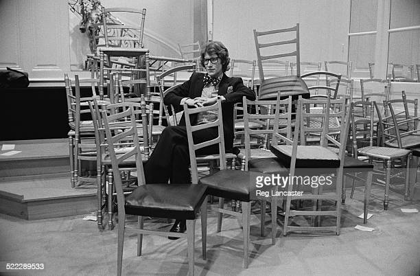 French fashion designer Yves Saint Laurent backstage at a fashion show, 22nd January 1972.