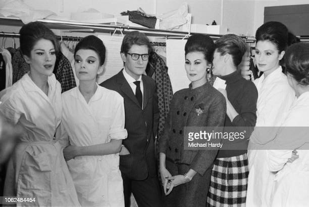 French fashion designer Yves Saint Laurent backstage with fashion models at a fashion show, UK, 4th February 1963.